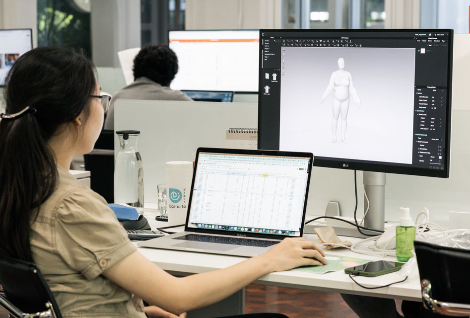 image of a woman using laptop and computer screen